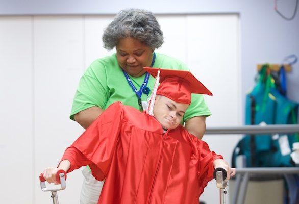 Focus, Determination Drive Spina Bifida Patient to Achieve Life-Long Goal at Graduation