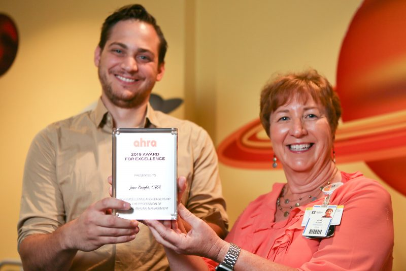 Ryan Pavlak and Jane Beight pose with award