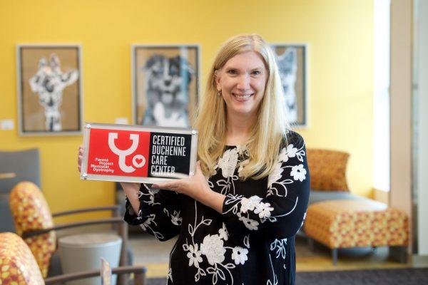Dr. Kathryn Mosher holding certification