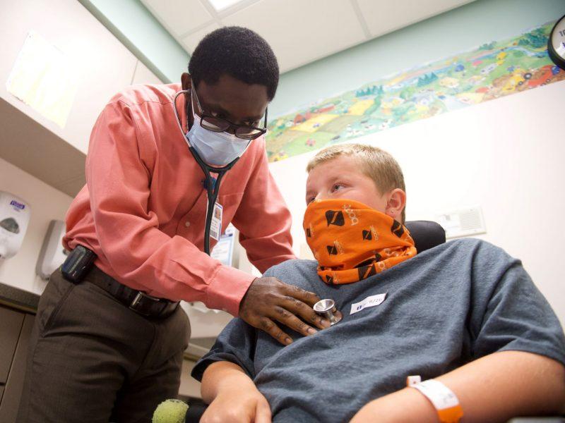 Dr. Manu assesses patient