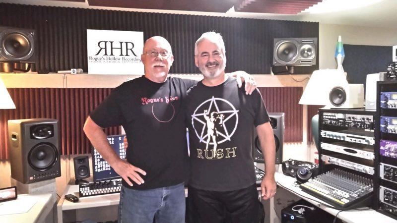 Chuck Reid with friend at recording studio